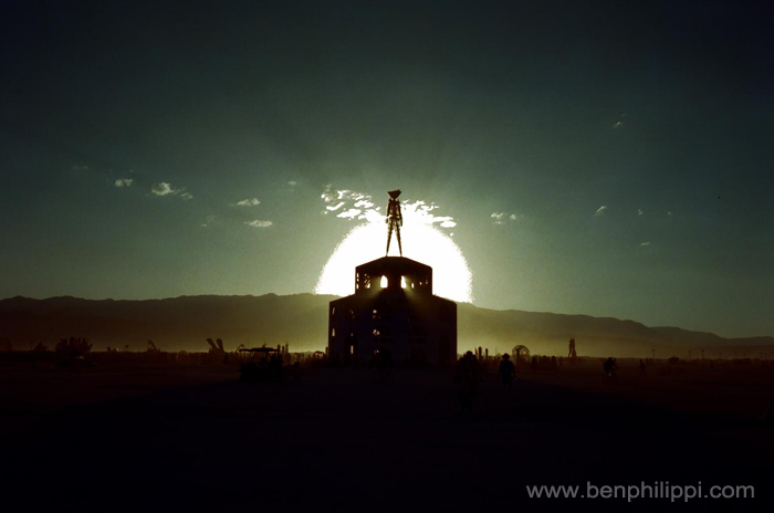 Sun setting behind Burning Man.